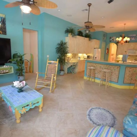 CSE Properties - Natalya's Tropical Estate Paradise Kitchen and Living Room