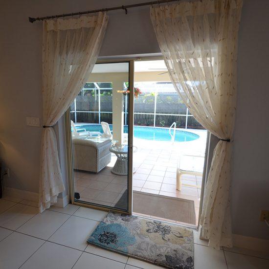 CSE Properties - Vanderbilt Vacation Villa Living Room Lanai Slider